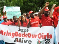 Members of civil society groups hold banners and shout slogans as they protest the abduction of Chibok school girls during a rally pressing for the girls' release in Abuja on May 6, 2014, ahead of World Economic Forum.