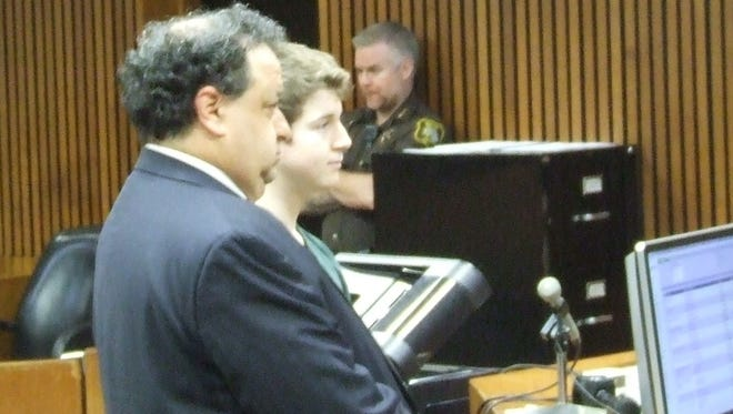 Defense attorney David Nacht with Brendan Sibel as Sibel was sentenced Friday in Wayne County Circuit Court for making bomb threats at Canton High School.