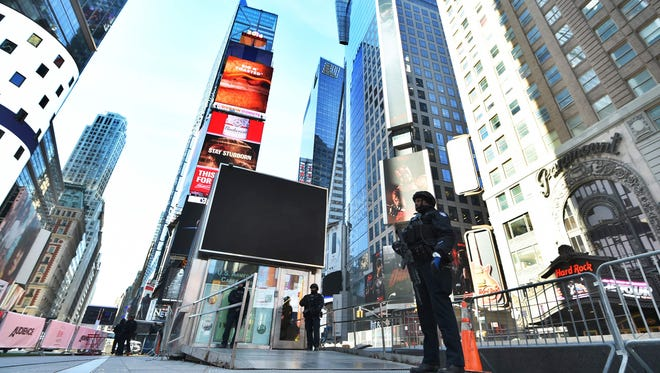 New York Police Department officers patrol in Times Square on March 22, 2016.