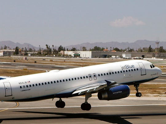 In this April 18, 2007, file photo, an Airbus A320 JetBlue aircraft lands at the Bob Hope Airport in Burbank, Calif. A JetBlue flight in December 2017 continued to its final destination after three passengers reported a mother mistreating her 8-year-old son, including grabbing him by the neck and shoving him against a window as he cried. Flight crews can restrain passengers or even divert flights when fights or other violent behavior erupts midair, but when the situation involves a parent potentially abusing a child, the decisions are not so clear cut.