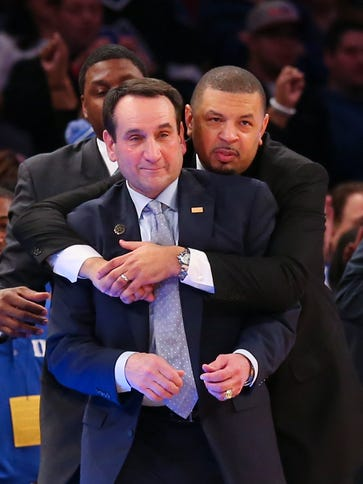 Duke Blue Devils head coach Mike Krzyzewski (left)