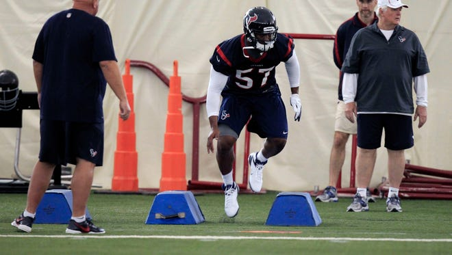 Sam Montgomery works out for the Texans during minicamp in May of 2013.