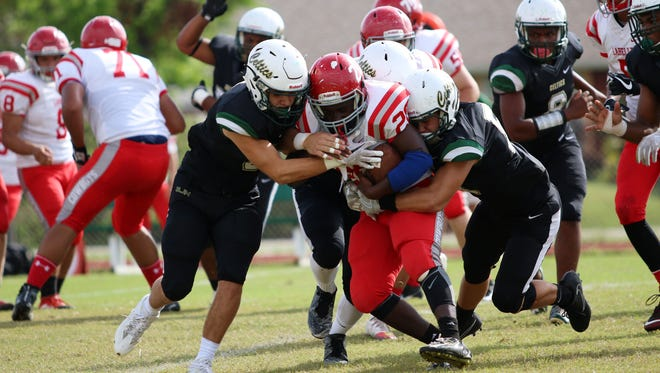 The Celtic defense takes down LaBelle running back Fred Davis during Saturday morning's Big 6 Conference game against LaBelle in Naples.
