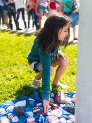 Delany Canup places a rock for 9/11 remembrance at