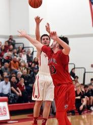 Grey Bennett shoots a 3-pointer over Fairfield Union's