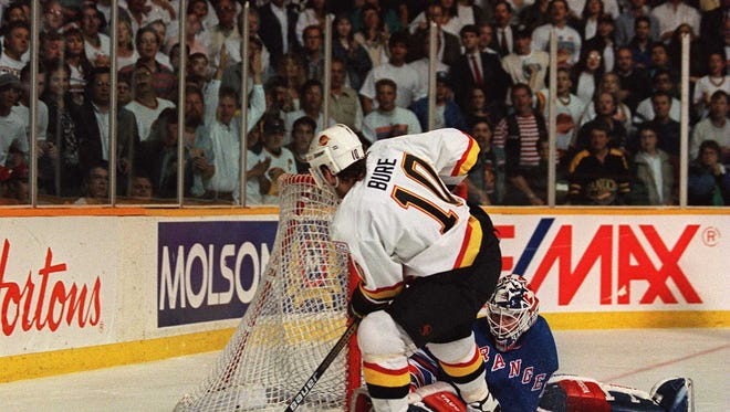 Rangers goaltender Mike Richter stops Canucks star Pavel Bure on a penalty shot during Game 4 of the 1994 Stanley Cup Final at the Pacific Coliseum in Vancouver, British Columbia. The Rangers won that night to take a 3-1 series lead, but losses in Games 5 and 6 set up a dramatic Game 7 on June 14, 1994.
