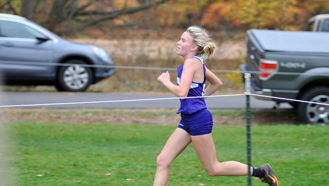Lexington senior Dominique Clairmonte easily won last week's Division II girls cross country district in Galion, despite not feeling well.