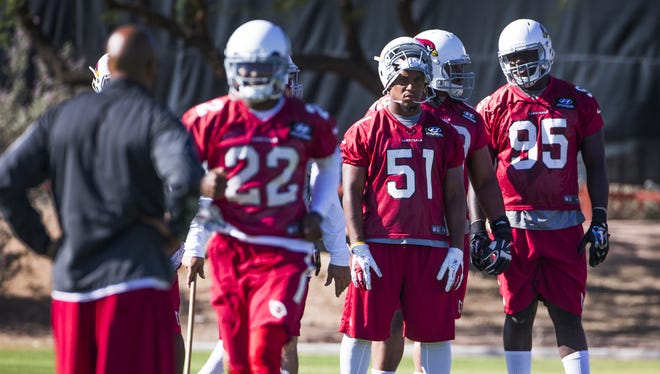 Arizona Cardinals safety Tony Jefferson, 22, linebacker Kevin Minter, 51, and defensive end Rodney Gunter, 95, wait their turn at practice, Monday, June 1, 2015.