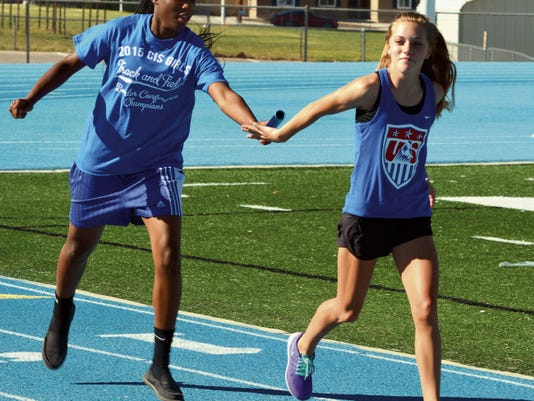 Matt Hollinshead — Current-Argus Cavegirls eighth grader Dayshaun Moore hands off the baton to freshman Rylee Hoover during medley relay practice on Wednesday. Carlsbad will send fifteen athletes to 6A state meet Friday and Saturday.