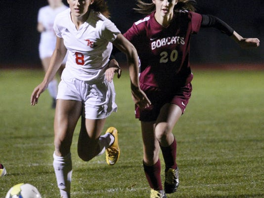 Annville-Cleona junior Reagan Hess runs to the ball against West Shore Christian's Anna Horton during the Little Dutchmen's 6-0 win in their District Three Class A tournament first-round game against West Shore Christian on Monday.
