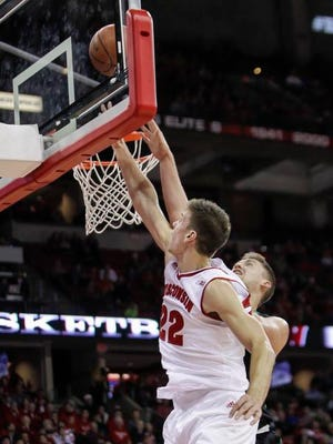 Wisconsin's Ethan Happ (22) shoots over North Dakota's Carson Shanks (5) during the second half of an NCAA college basketball game Tuesday, Nov. 17, 2015, in Madison, Wis. Wisconsin won 78-64. (AP Photo/Andy Manis)
