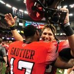 UL placekicker Brett Baer celebrates his game-winning field goal in the first New Orleans Bowl win over San Diego State with quarterback Blaine Gautier (17).