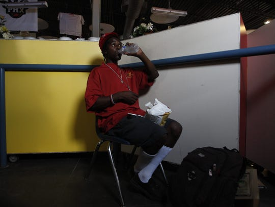 Raheem Wilson from San Diego drinks water at the Central