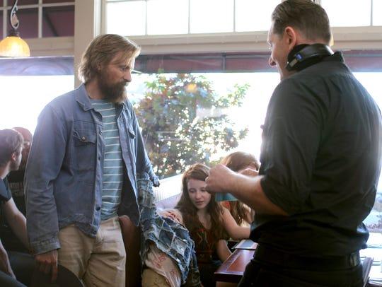Viggo Mortensen (left) and Matt Ross discuss a scene