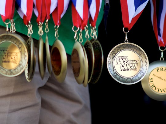 Medals for cancer survivors are pictured during the SUBWAY Race Against Cancer 5K in support of Thompson Cancer Survival Center on Sunday, Nov. 13, 2016, at the World's Fair Park.  (Shawn Millsaps/Special to News Sentinel)