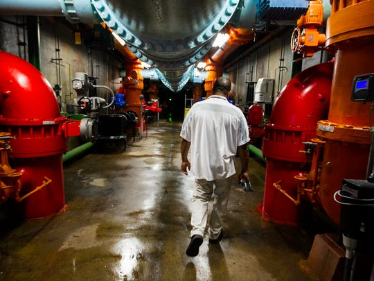Roland Person, supervisor of water operations for Memphis Light, Gas and Water, walks through the basement of the water filtration system at the Sheahan pumping station in this July 2015 photo.
