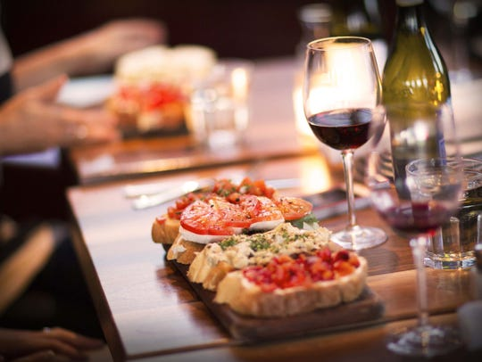 Postino Wine Cafe's bruschetta paired with a glass