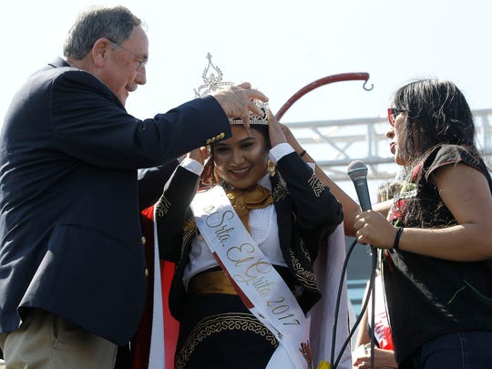 Eliza Sanchez is crowned Miss Señorita Grito 2017 by Mayor Joe Gunter on the main stage at the corner of East Alisal and Madeira St. during El Grito Festival on Sunday, September 17, 2017 in Salinas, Calif. Vernon McKnight/for The Californian