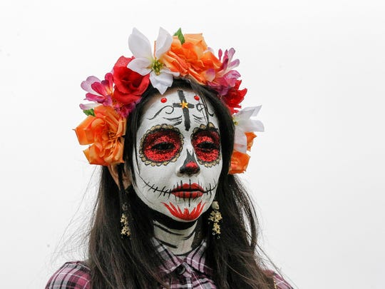 A woman with a La Catrina face competing in La Catrina contest is pictured during Dia De Los Muertos/Day of the Dead at Natividad Creek Park on Sunday, October 29, 2017 in Salinas.