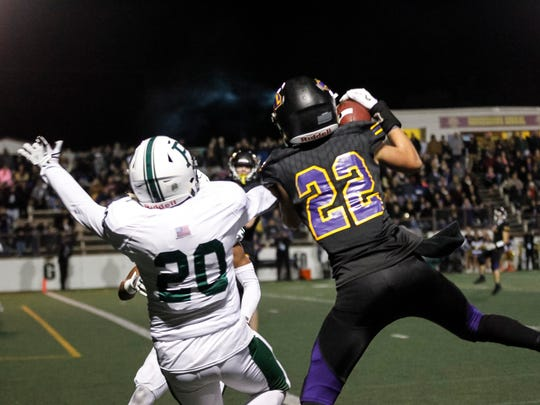 Salinas' Zachary Robison catches the pass over Palo Alto's Manny Soto for the only touchdown of the half during a Central Coast Section: Open Division I playoff football game between the Salinas Cowboys and the Palo Alto Vikings at the Pit at Salinas High School on Friday, November 17, 2017 in Salinas, Calif. Vernon McKnight/for The Californian