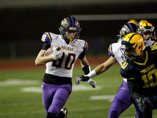 Salinas' Jeffrey Weimer returns a kickoff return for a long gain during a Central Coast Section: Open Division I Championship football game between the Salinas Cowboys and the Milpitas Trojans at Independence High School on Friday, December 1, 2017 in San Jose, Calif. Vernon McKnight/for The Californian