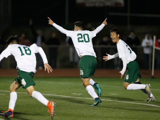 Alisal's Abraham Montano (20) celebrates with his teammates