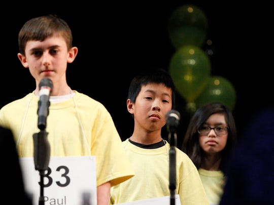 The final three contestants, from left, Paul Hamrick, eighth-grader at Lambert Hamrick Homeschool, Samuel Low, seventh-grader at Washington Middle School, and Megan Sacyat, eighth-grader at Main Street Middle School, stand in line during the Countywide Spelling Bee at Hartnell Community College on Sunday, March 4, 2018 in Salinas.
