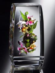 "Paul Stankard's paperweight, ""Orchid Bouquet Botanical,"" will"