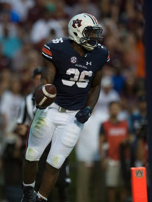 Auburn running back Kamryn Pettway (36) celebrates after scoring a touchdown during the Auburn vs. Texas A&M NCAA football game on Saturday, Sept. 17, 2016, at Jordan Hare Stadium in Auburn, Ala.