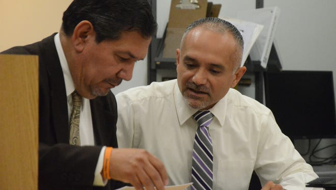 Luis Tejada, right, with his attorney Eusebio Solis at an earlier session.