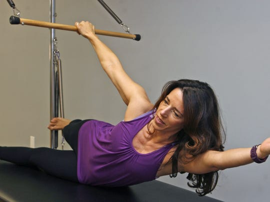 Renee' Millemann, owner and Pilates expert at Coastline Pilates, demonstrates some of her equipment in Toms River.