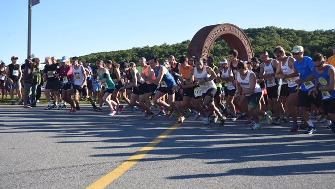 Runners in the half-marathon portion of the 2015 Dutchess County Classic begin the race at Arlington High School.