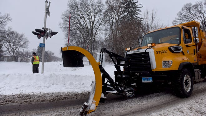 Snow plows cruise along Phillips Ave. in Sioux Falls on Wed., Jan. 25, 2017.