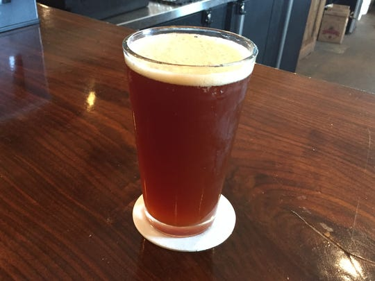 A pint of Blue Eyed Six, an ole ale made from a recipe created by former U.S. President Thomas Jefferson.