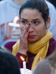 A Florida State University student wipes away tears during the Gathering of Unity candlelight vigil on campus after the shooting of three FSU students earlier in the day on November 20, 2014 in Tallahassee, Florida. About 3,000 students attended the vigil according to FSU Police Chief David Perry.