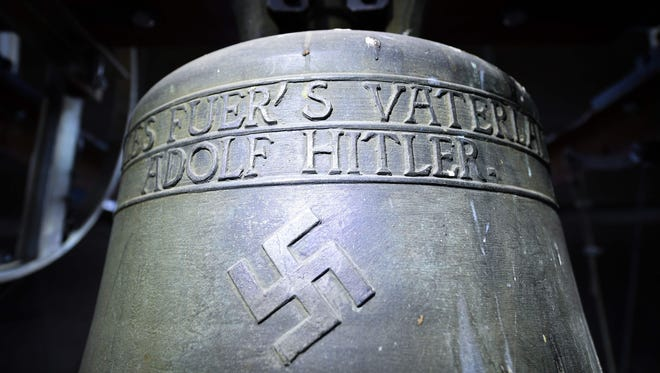 "Picture taken on May 19, 2017 shows a Nazi-era church bell that bears a swastika and the words ""All for the Fatherland  Adolf Hitler"" (""Alles fuer's Vaterland - Adolf Hitler"") hanging in the steeple of the St Jakob church in Herxheim am Berg, western Germany."