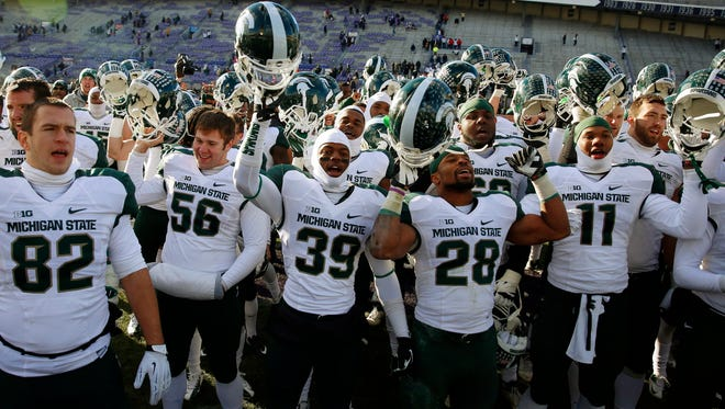 Michigan State players celebrate after their 30-6 victory against Northwestern that clinched a spot in the Big Ten title game.