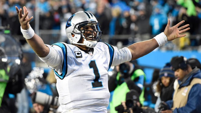 Carolina Panthers quarterback Cam Newton (1) celebrates during the fourth quarter against the Arizona Cardinals in the NFC Championship football game at Bank of America Stadium.