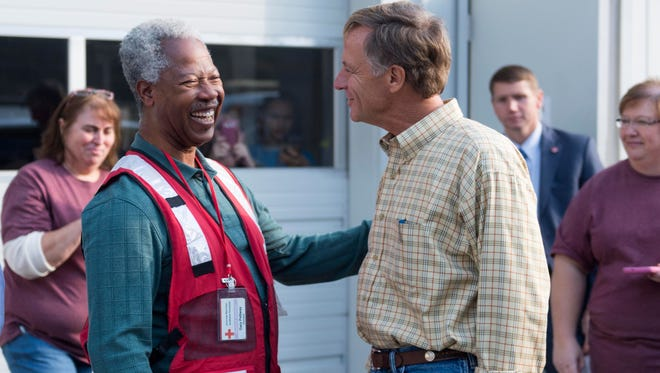 Tennessee Gov. Bill Haslam talks with American Red Cross volunteer Gary Pettway during a visit with volunteers and firefighters at Blount County Fire Station 5 on Wednesday, Nov. 23, 2016, in Walland.