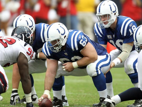 Indianapolis Colts center Jeff Saturday (63) snaps to Peyton Manning.