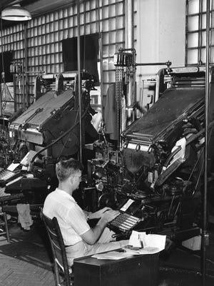 Linotype machine operators at the Asheville Citizen-Times in 1939.