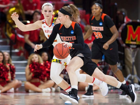 Princeton's Gabrielle Rush, right, handles the ball as Maryland's Kristen Confroy, left, defends during the first half of a first-round game in the NCAA women's college basketball tournament in Raleigh, N.C., Friday, March 16, 2018. (AP Photo/Ben McKeown)
