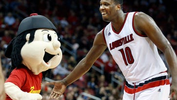 Louisville's Jaylen Johnson and Bompy have a little fun during a timeout.  Dec. 23, 2015