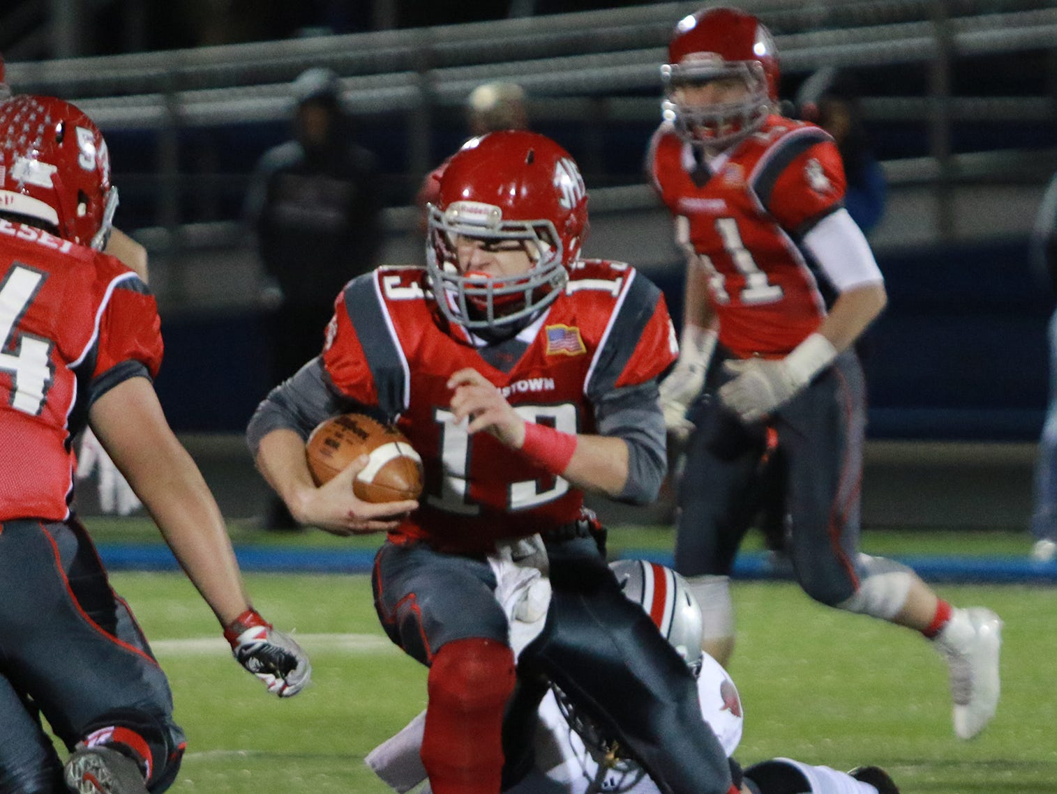 Cody Workman runs the ball down the field avoiding the attempted tackles of St. Clairsville to score the first touchdown of the game.