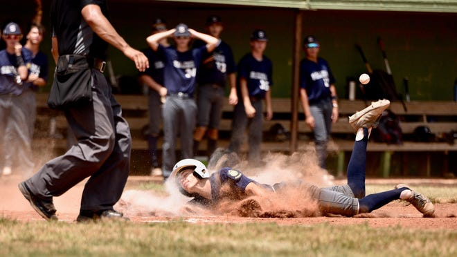 The Salina Hawks' Mason Gary slides safely into home during Sunday's Kansas Grand Slam semifinal game at James Matson Field. The Hawks beat the Omaha Wolfe Electric Cats 10-2, but lost the championship game, 19-3, to Omaha Sportclips.