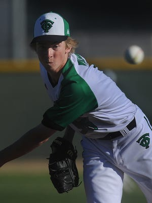 Thousand Oaks' Royal Wilson throws a pitch in a complete-game, one-hit, 3-0, shutout, at home against Oaks Christian.