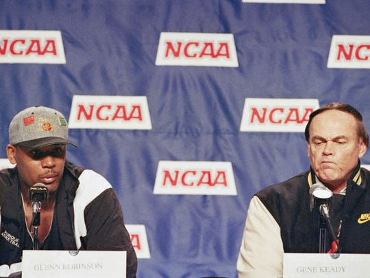 Purdue's Glenn Robinson, left, responds to a question during a news conference in Lexington, Ky., on March 18, 1994. Robinson was asked what kind of guy coach Gene Keady, right, is ahead of facing Alabama in the second round of the NCAA Southeast Regional tournament Saturday at Rupp Arena.