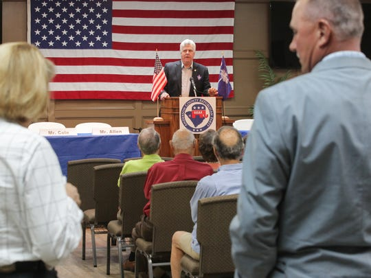 Anderson County Republican Party President Dan Harvell (middle) welcomes Anderson County Council members Tommy Dunn (right) and Cindy Wilson (left), and a crowd of over 50 to a forum about a proposed 2 percent hospitality tax, held at Concord Community Church in Anderson.