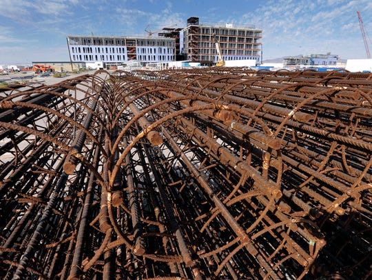 Rebar is stacked near the six-building William Beaumont