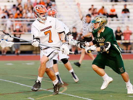Central York's Robert Stockbower, left, works to move
